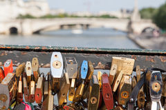 PARIS - JULY 27: Lockers at Pont des Arts symbolize love for eve. R, July 27, 2013 in Paris. 16000 lockers of loving couples are on that bridge, also known as stock image