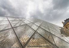 PARIS - JULY 2014: Louvre exterior architecture. Paris attracts. 40 million visitors annually Royalty Free Stock Photography