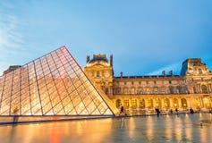 PARIS - JULY 2014: Louvre exterior architecture. Paris attracts. 40 million visitors annually Stock Photo