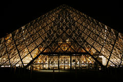 Paris - July 1: The Louvre museum at night with it Stock Photo