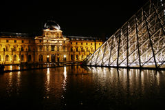 Paris - July 1: The Louvre museum at night with it Royalty Free Stock Photography