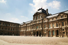 PARIS - JULY 1: Partial facade of the Louvre museu Stock Photography