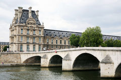 PARIS - JULY 5: Partial facade of the Louvre next  Royalty Free Stock Photo