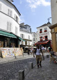 Paris,July 17:Street view with Le Consulat from Montmartre in Paris Royalty Free Stock Photography