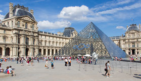 PARIS - JULY 28, 2013. Tourists enjoy the weather at the Louvre Stock Image