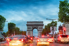 PARIS - JULY 7, 2014: Traffic along Triumph Arc at sunset. Traff Stock Photography