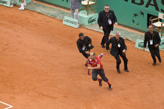PARIS - JUNE 7:. Infringer ran in on court with flag at French Open, Roland Garros on June 7, 2009 in Paris, France royalty free stock photo