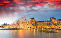 PARIS - JUNE 17, 2014: Beautiful sunset over Louvre Museum archi Stock Photography