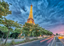 PARIS - JUNE 11, 2014: Lights of Eiffel Tower at night. La Tour Royalty Free Stock Images