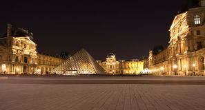 PARIS - June 1: Louvre museum in Paris, France at night on June. 1, 2011. Louvre is the most famous, most popular and the biggest museum in Paris Royalty Free Stock Images