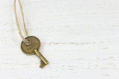 Paris key on a white distressed wood background Stock Photography