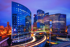 Paris - La Defense. Modern buildings in the busy la Defense quarter in Paris, France. Longtime exposure with traffic lights Royalty Free Stock Image