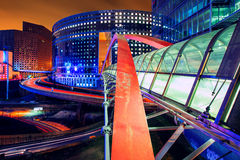 Paris - La Defense. Modern buildings in the busy la Defense quarter in Paris, France. Longtime exposure with traffic lights Royalty Free Stock Photography