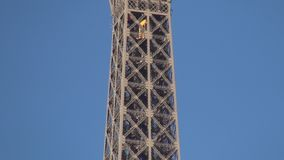 Paris Landmark Eiffel Tower Metallic Structure with One Elevator in Ascension.  stock video