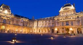 Paris, Louvre Museum Evening. Principal landmark and touristic spot of Paris, France: the Louvre museum Museum du Louvre at late evening with blue sky as a Royalty Free Stock Photo