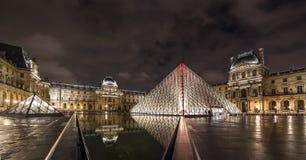 Paris Louvre Museum night view. Paris Louvre Museum pyramid and building night light royalty free stock photo