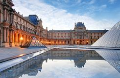 Paris - Louvre museum at sunrise Stock Photography