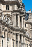 Paris and the Louvre with statues Royalty Free Stock Image