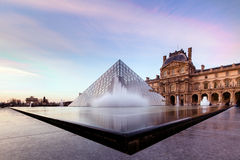 Paris Louvre Twilight water. Paris, Pyramid Louvre at Twilight with water foutain Royalty Free Stock Photo