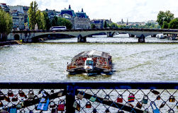 Paris from the love bridge, in front of Notre Dame. PARIS-JUNE 07: BATEAUX MOUCHES – one of the classic tourist experiences in Paris, on June, 07, 2012 Stock Images