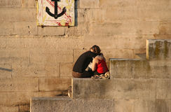 Paris Lovers. Couple embracing on the bank of the Seine royalty free stock photography