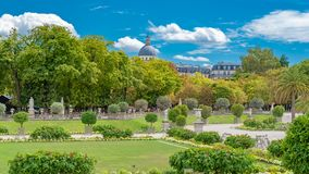 Paris, the Luxembourg garden. Beautiful public park, with ancient buildings in background royalty free stock image