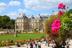 Paris - Luxembourg Palace. PARIS - JULY 24: Tourists stroll in Luxembourg Gardens on July 24, 2011 in Paris, France. Luxembourg area is popular among tourists in stock photo