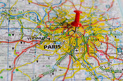 Paris on map. Close up shot of Paris France on a map with red push pin Royalty Free Stock Image