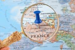 Paris map tack. Magnifying glass over Paris, France map with destination tack Stock Photos