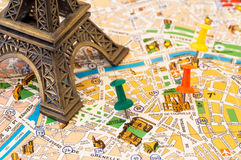 Paris map visiting places. Detailed map of Paris with a detail of eiffel tower and pins marking places of interest in the city royalty free stock photography