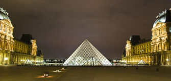 PARIS - MARCH 20: Louvre Pyramid shines at night Stock Photos