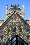 PARIS - MARCH 23:. Louvre Pyramid on March 23, 2011 in Paris. Louvre is the biggest Museum in Paris displayed over 60,000 square meters of exhibition space Royalty Free Stock Photography
