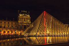Louvre Museum and the Pyramid in Paris Royalty Free Stock Photography