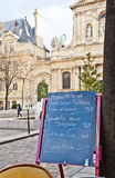 Paris - Menu in a restaurant. Black board with a menu restaurant in a tipical traditional square in Paris royalty free stock photography