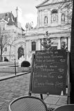 Paris - Menu in a restaurant. Black board with a menu restaurant in a tipical traditional square in Paris royalty free stock image