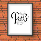 Paris Message on a White Frame Hanging on a Wall Stock Images