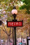 Paris metro. Red metro sign in Paris France on background of fall trees royalty free stock photos