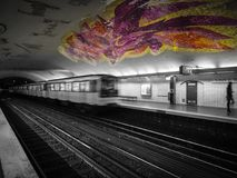 Mosaic ceiling in gaudy colors in the Paris metro. Paris Metro with a brightly colored mosaic ceiling royalty free stock photography