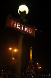 Paris metro and Eiffel Tower at night Stock Photography