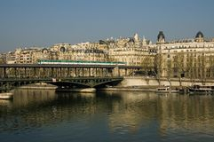 Paris Metro over the bridge. The Paris metro crosses the river high in the air Royalty Free Stock Photography