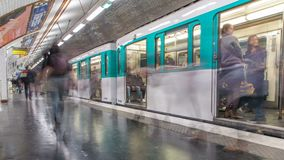 Paris Metro platform timelapse. It is the one of the largest underground system in the world. Paris, France. Paris Metro platform timelapse. Trains trains arrive stock footage