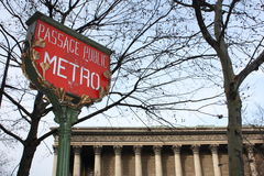 Paris Metro Sign. History sign for Paris Metro system with Church La Madeleine in backround stock photography