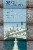 Paris metro sign. With reflection of Alexander III Bridge Royalty Free Stock Image