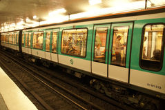 A Paris Metro train arrives at station Royalty Free Stock Images