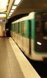A Paris Metro train arrives in an underground station Stock Photos
