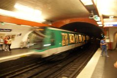 A Paris Metro train arrives in an underground station Stock Photo