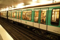 A Paris Metro train arrives in an underground station Royalty Free Stock Photography