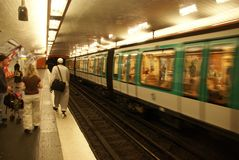 A Paris Metro train arrives in an underground station Stock Photography