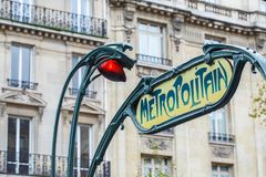 Paris Metropolitain entrance station. A pole with traditional me stock photo