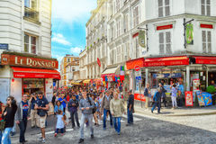 Paris- Monrmatre street with peoples. Stock Images